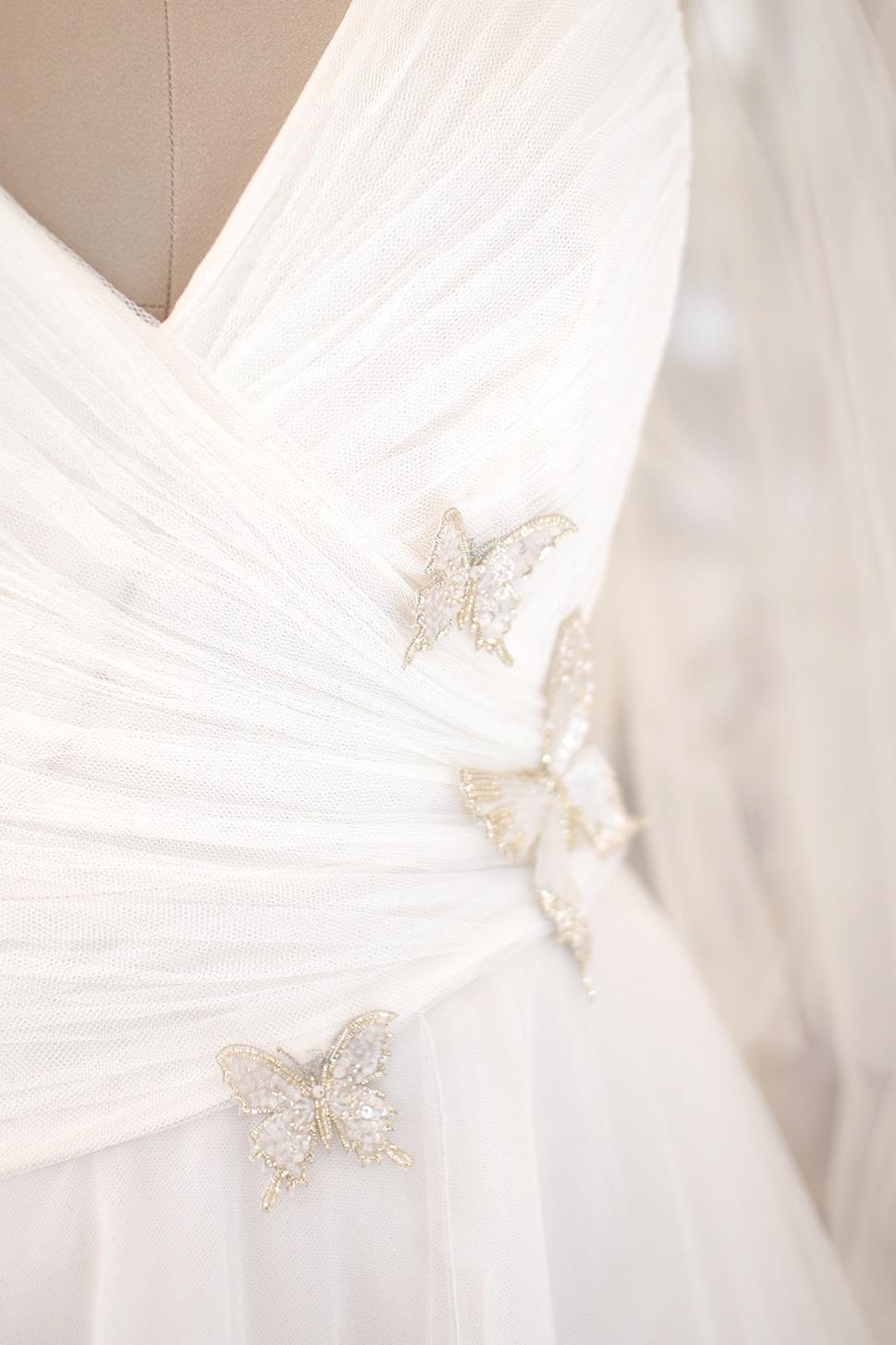 détails broderie robe de mariée